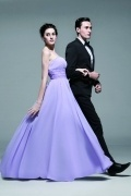 Long formal dress in chiffon with embroidery around waist