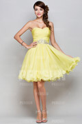 Short formal dress in yellow tone with beaded details