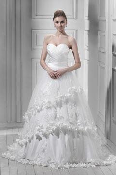 Robe de mariée de luxe à couche florale à l'extérieur à volants avec appliques