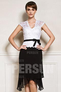 Cap sleeve knee length cocktail dress in black and white