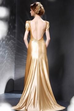 Robe de soirée dos nu dorée à l'épaulette