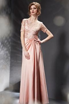 Robe rose de soirée pailletée transparente au niveau de la poitrine
