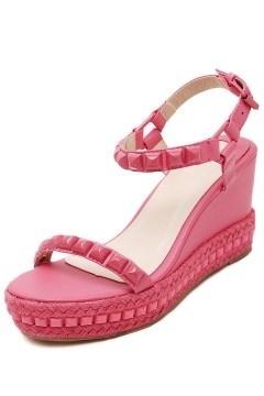 Sandales compensées en rose corail ornée de clous