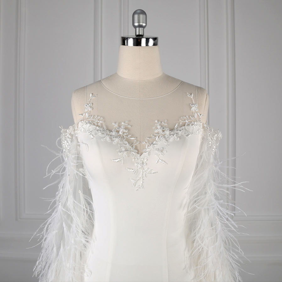 Robe de mariée plume bustier coeur 2021