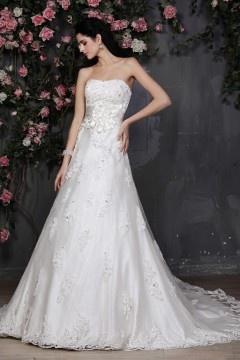 Robe de mariée bustier dentelle ornée de fleurs fait main à la taille