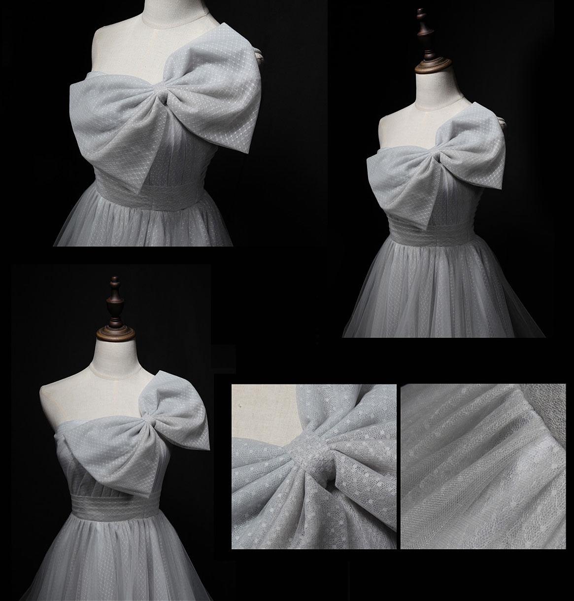 petite robe grise pour anniversaire asymétrique avec  un noeud