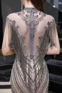 Robe de soirée sirène de luxe travaillée de bijoux et franges somptueux