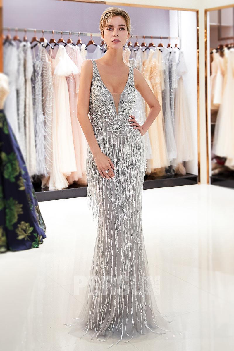 robe de soirée argenté longue col v plongeant embelli de strass et de franges