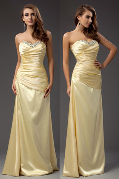 Robe de soirée moulante bustier coeur bustier jaune en satin ornée de bijoux