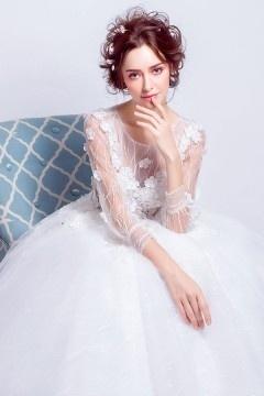 Robe de mariée bustier transparent fleuri avec manches trois quart