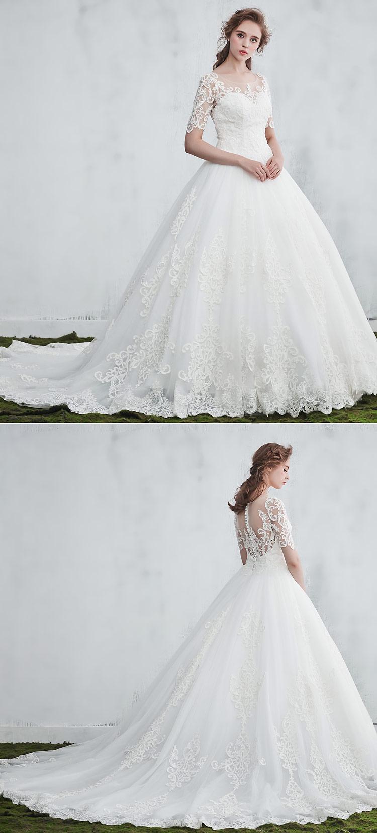 robe de mariée longue princesse appliquée de dentelle guipure style baroque