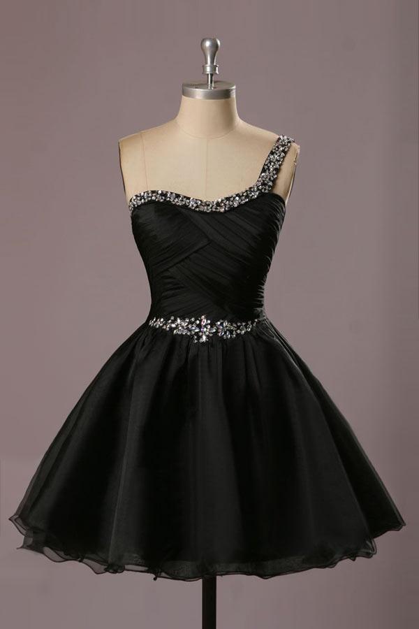 petite robe noire col asymétrique ornée de strass à jupe évasée