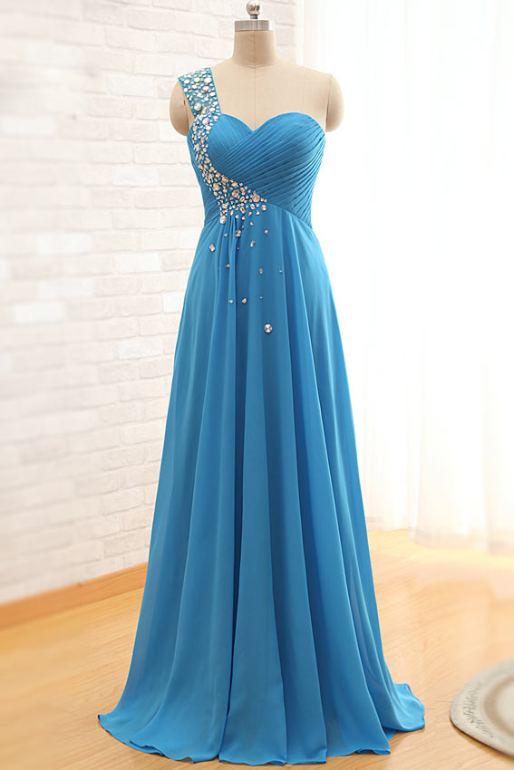 magnifique robe bleu longue ornée de bijoux
