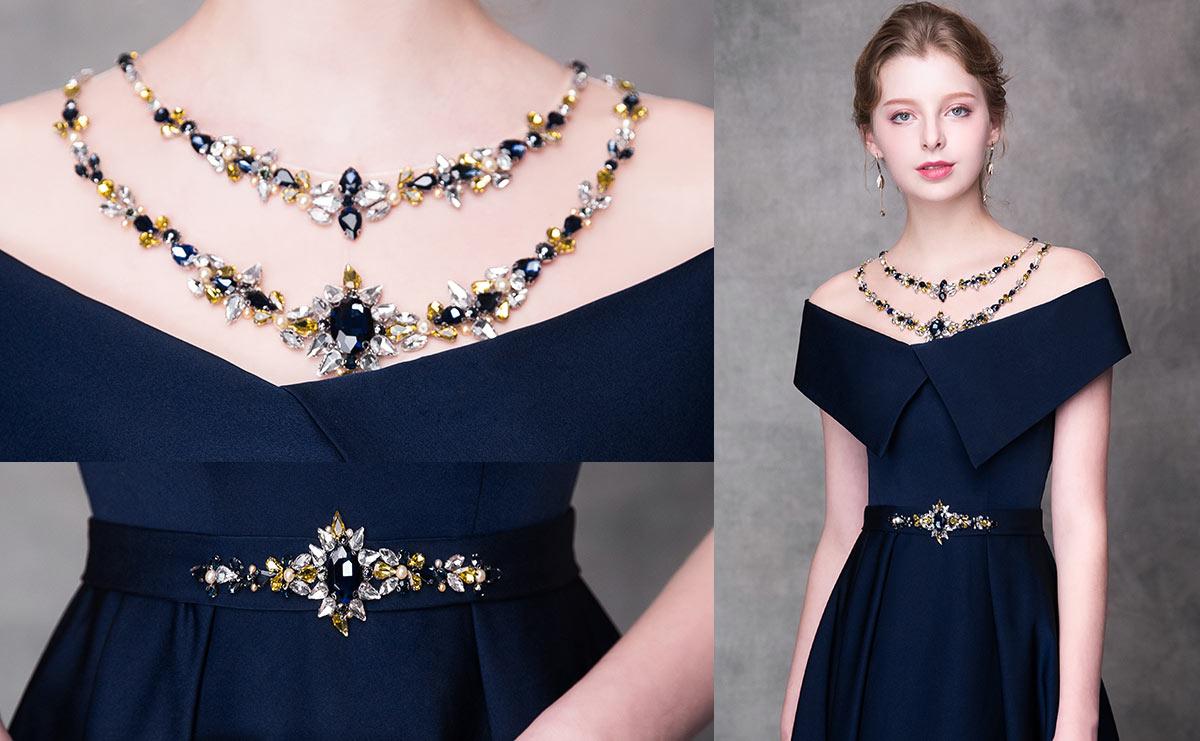 robe de gala bleu marine encolure & taille embelli de bijoux