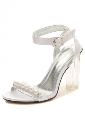 Sandale soirée blanche à talon haut transparent ornée de perles