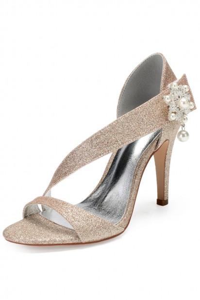 Sandale asymétrique champagne doré dotée de bijoux pour soirée