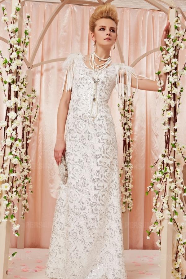 Robe blanche longue dentelle pailletée à franges