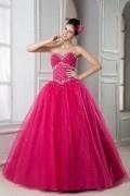 Robe de soirée princesse fuchsia bustier coeur corsage pailleté