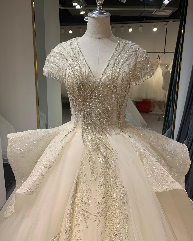 robe de mariée de luxe scintillante pour mariage église