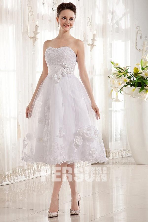 Robe mariée bustier coeur ornée de fleurs en tulle