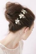 3 pics coiffure mariage avec feuilles émail strass & perles