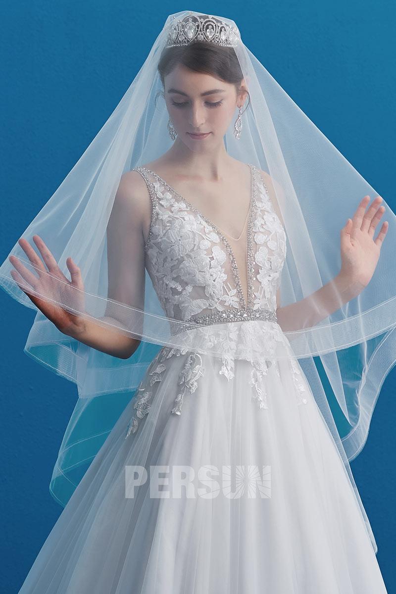 robe de mariée élégante col v plongeant bustier transparent embelli applique floral