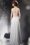 Robe de soirée blanche bustier ornée avec fleurs et bijoux