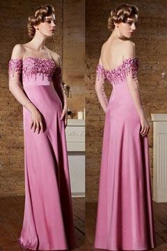 Robe haute couture fuchsia claire avec manches mi longue épaules dénudées