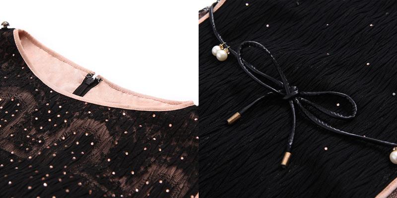 Robe de soirée col rond noire ornée de bijoux