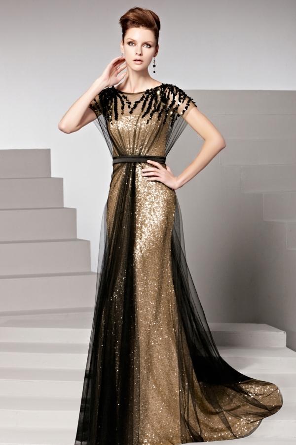 Robe dorée tulle noir pailletée ceinturée ornée de rhinestones ... 92213f6ec09d