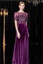 Robe soirée de luxe longue velours violette à haut embelli de bijoux