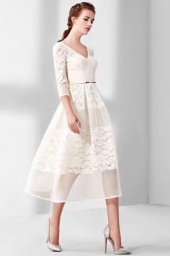 Robe de mariée dentelle à fleurs empiècements col V à manche