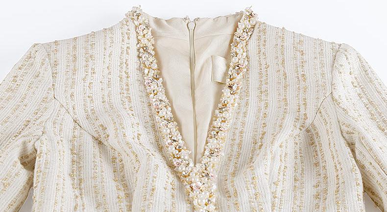 robe maille longue col v décoré de bijoux