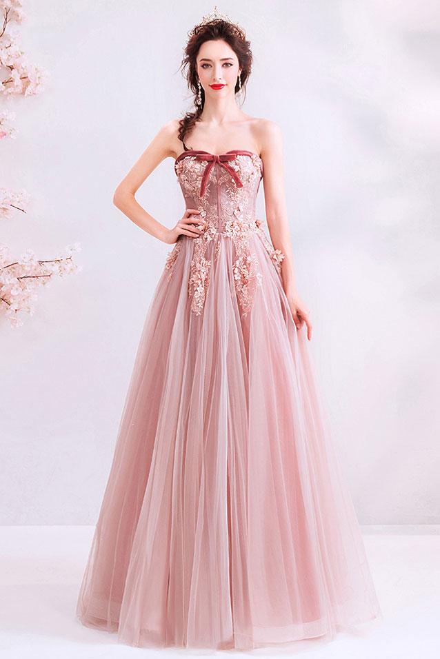 robe de mariée rose bustier coeur embelli de noeud papillon appliquée de fleurs 3D