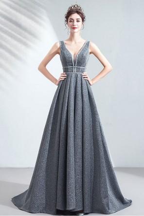 Robe de soirée longue grise scintillant décolleté plongeant jupe ample