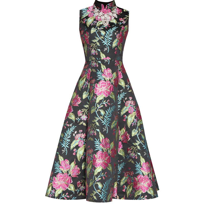 petite robe vintage noire cocktail broderie fleurie jupe évasée